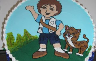 icing drawing of diego on cake