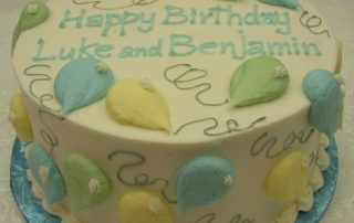 Individual balloons on birthday cake