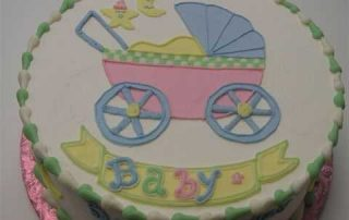 drawing of baby carriage on cake, baby shower cake