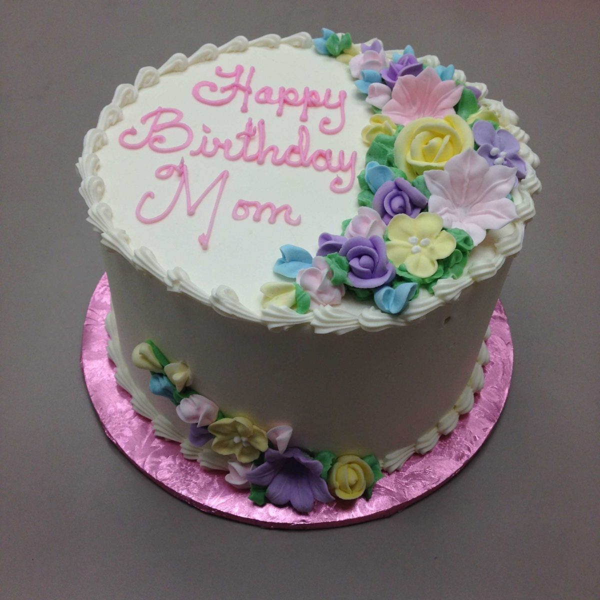 flowers on top of cake, flowers on side of cake
