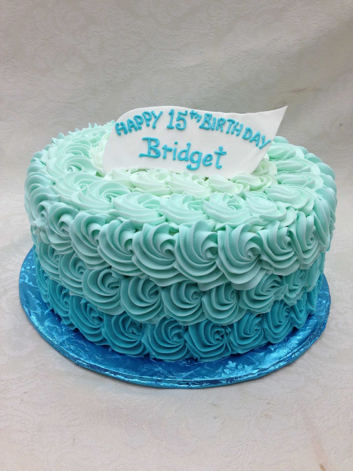 All over rosettes on ombre cake design