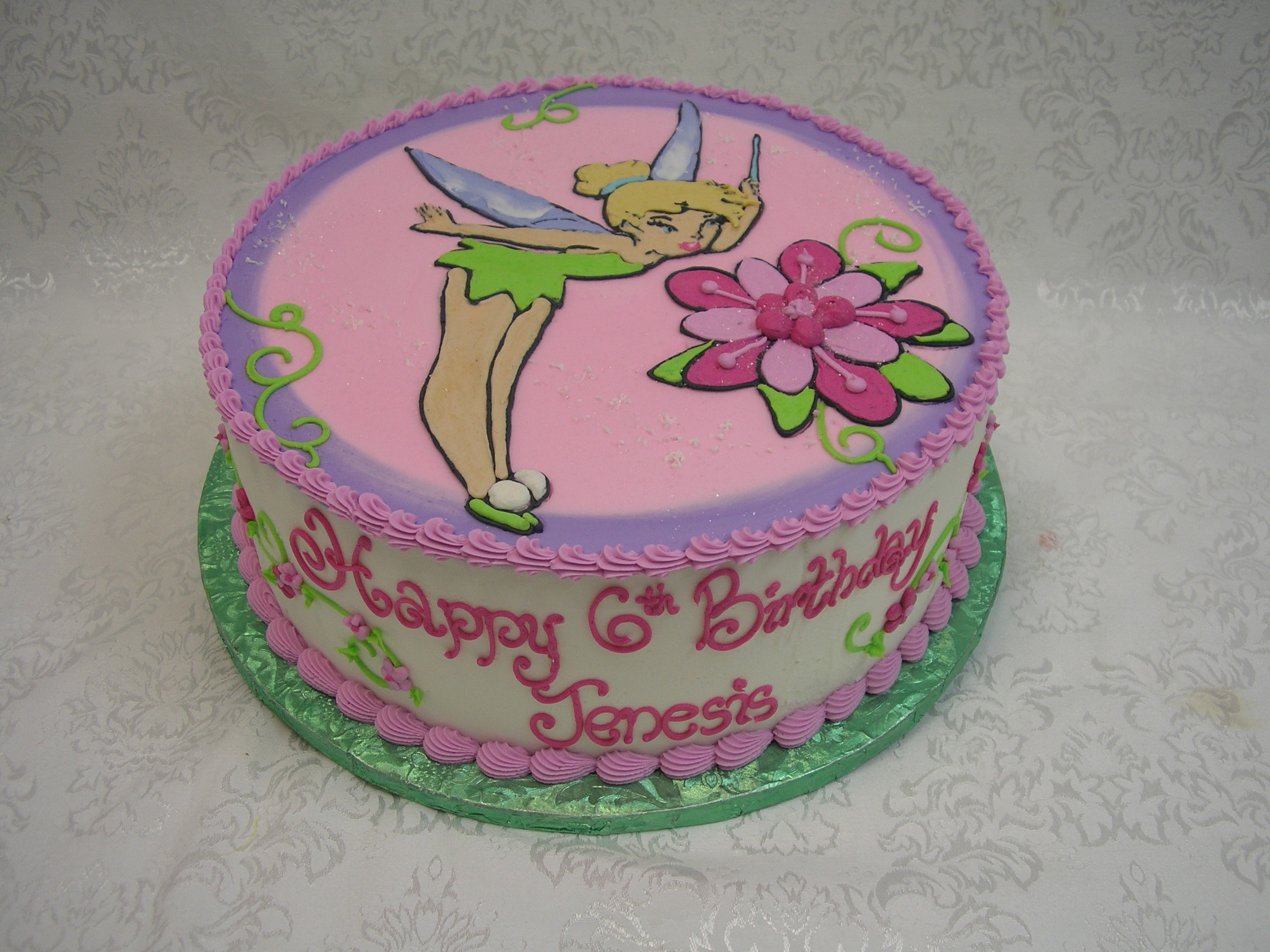 icing drawing of tinker bell on cake