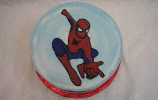 icing drawing of spiderman on cake