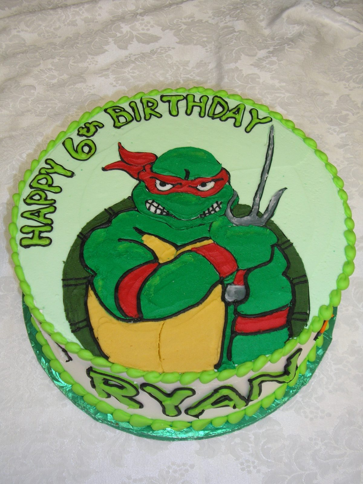 icing drawing of a ninja turtle on a cake