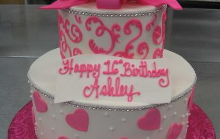 multi tier scrolls and hearts cake