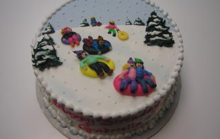 piped on sleds on cake