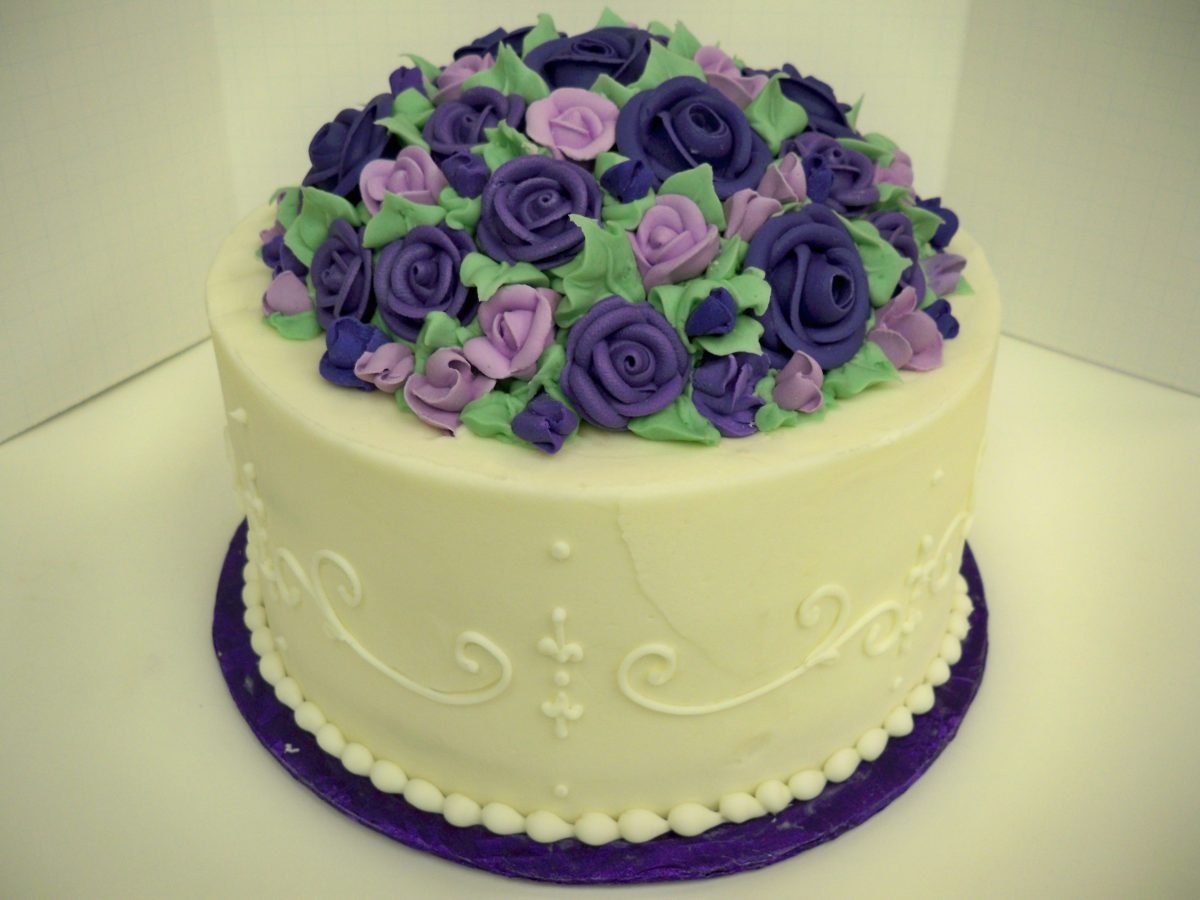 center cluster of flowers on top of the cake