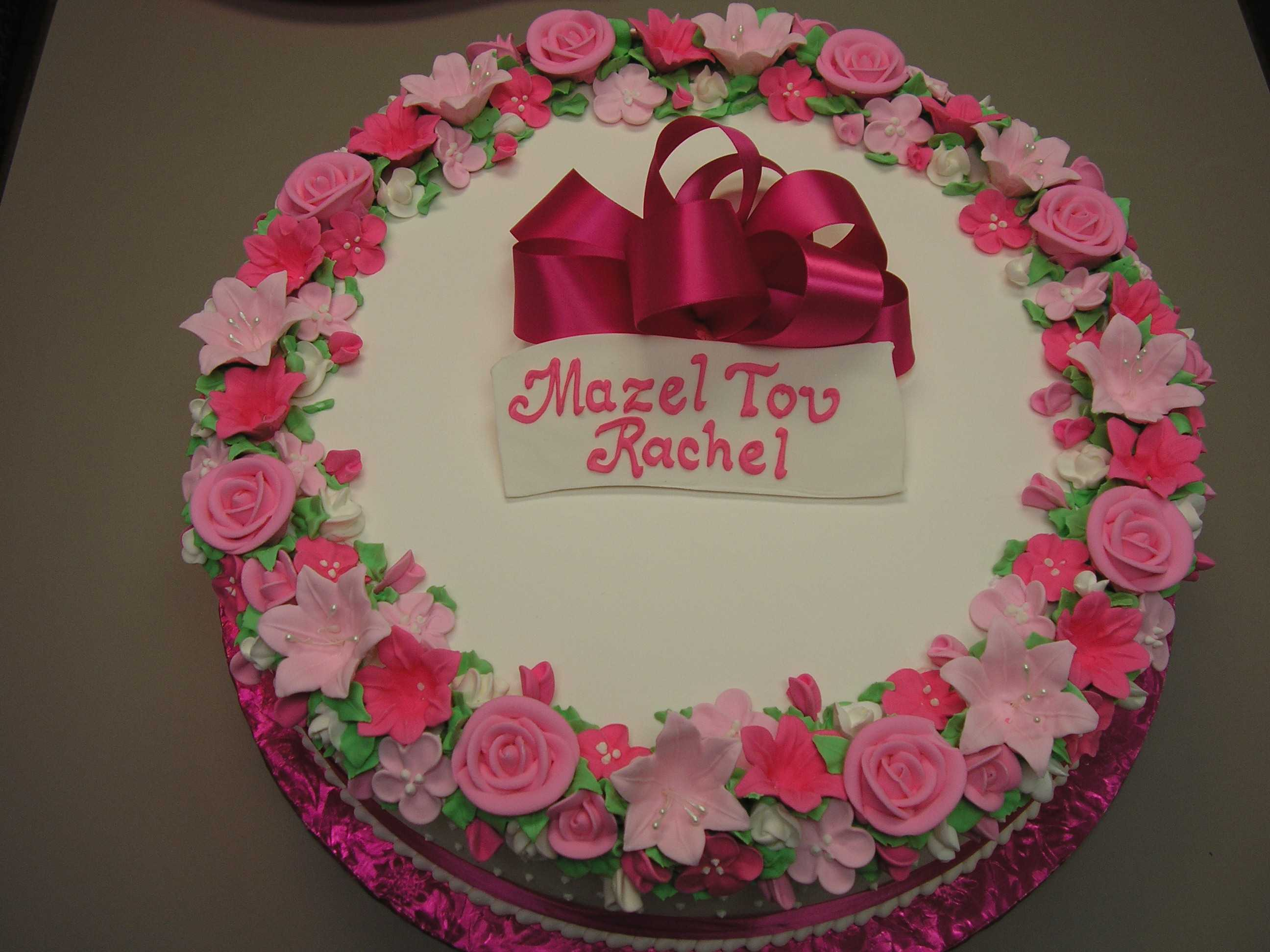 ring of flowers design around top of cake