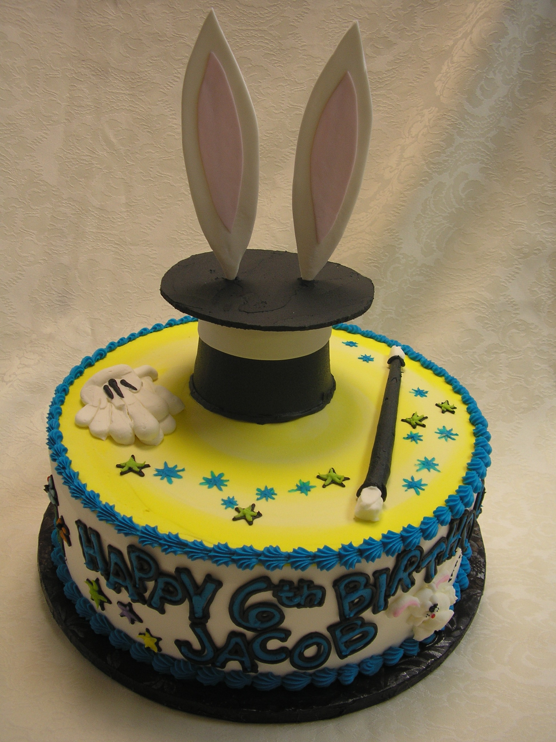 3 D magician cake. rabbit out of the hat cake