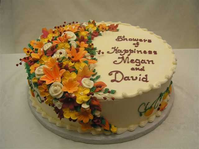 arc of flower cake in fall colors