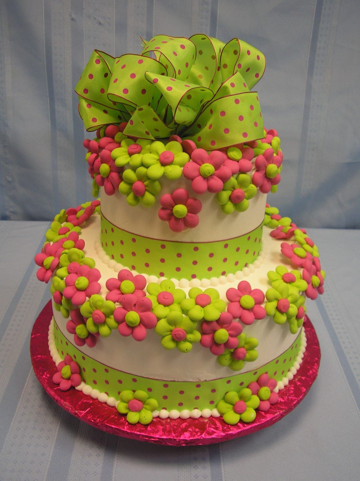 two tier gift bow and flower cake