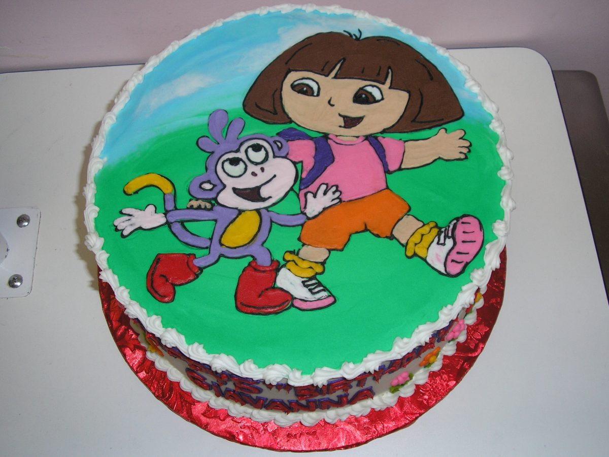 dora and boots cake, icing drawing of dora on cake