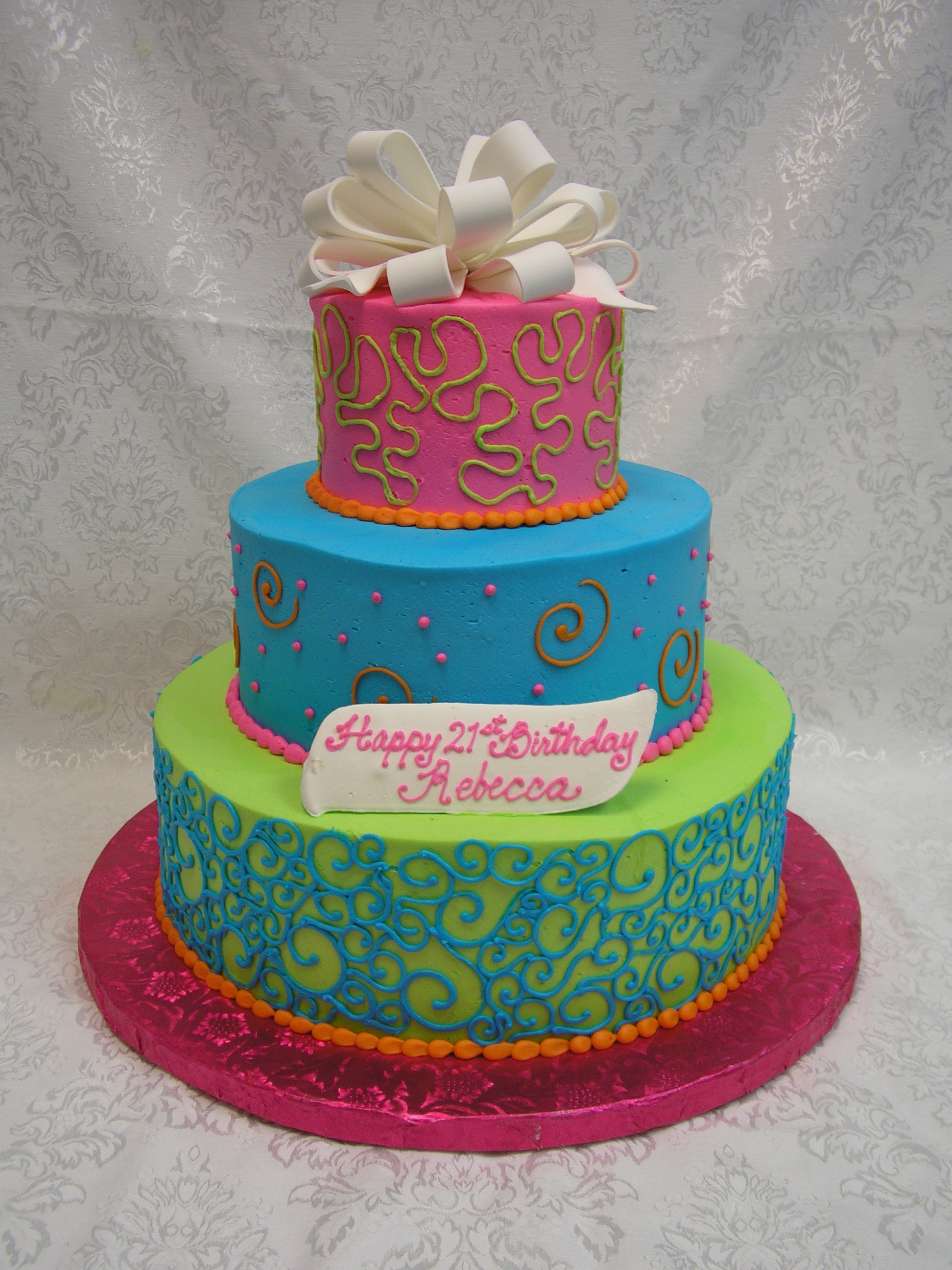 3D scrolls and dots cake with fondant bow
