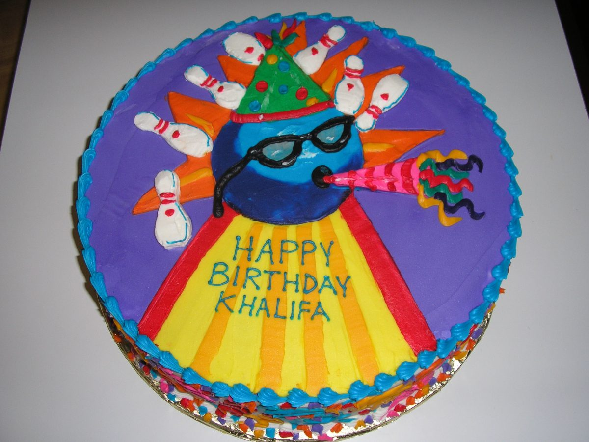 icing drawing of bowling balls and pins on cake