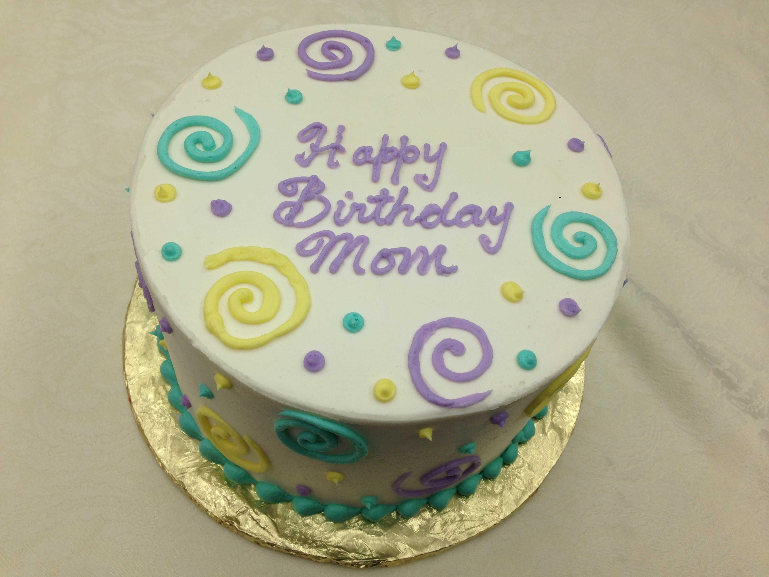 birthday cake with dots and swirls