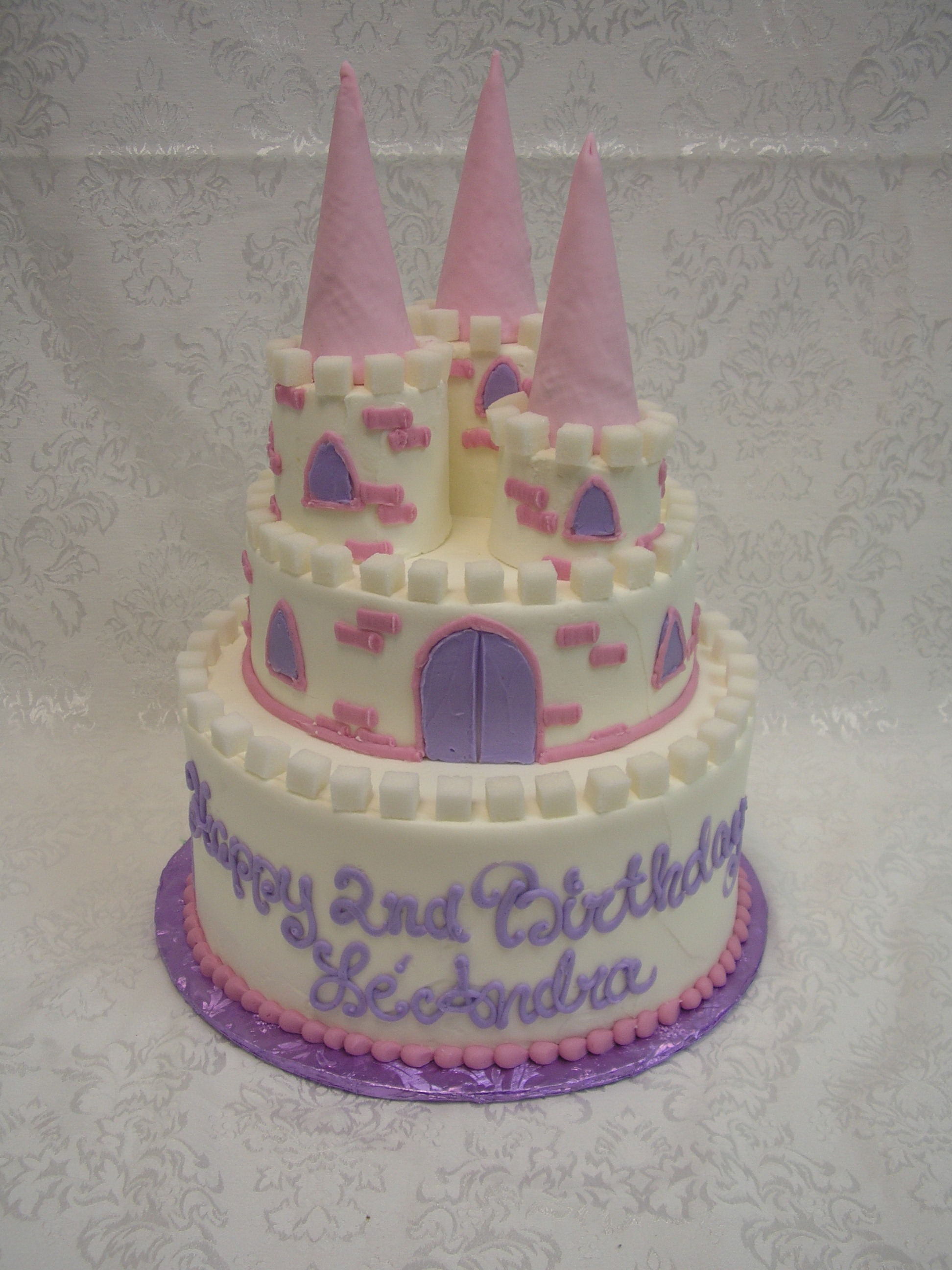2 tier castle cake, 3d turrets on a 2 tier castle cake