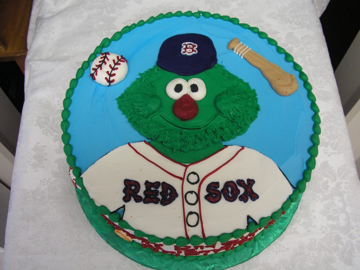 icing drawing of wally the green monster on cake