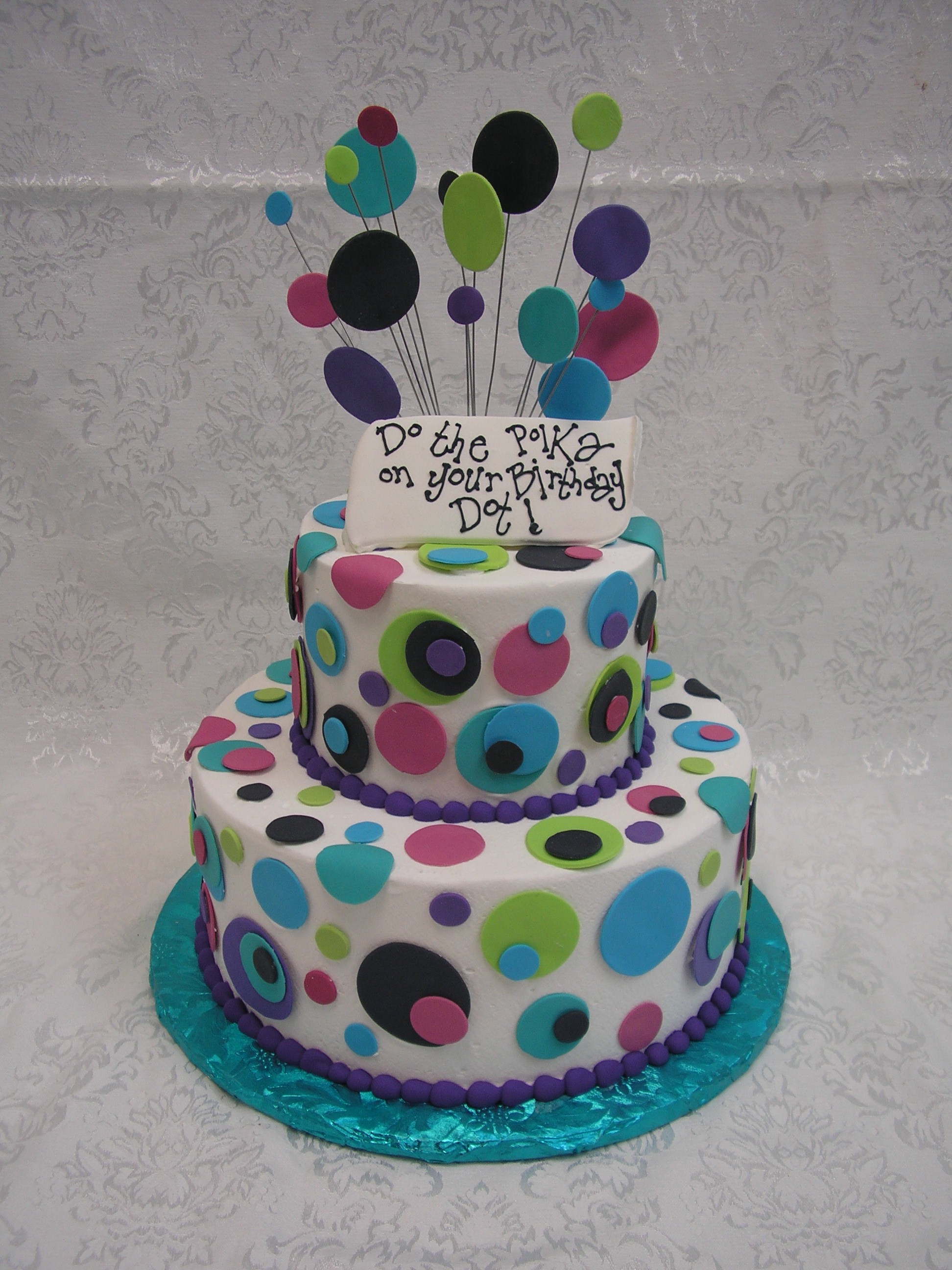 two tier cake with polka dots