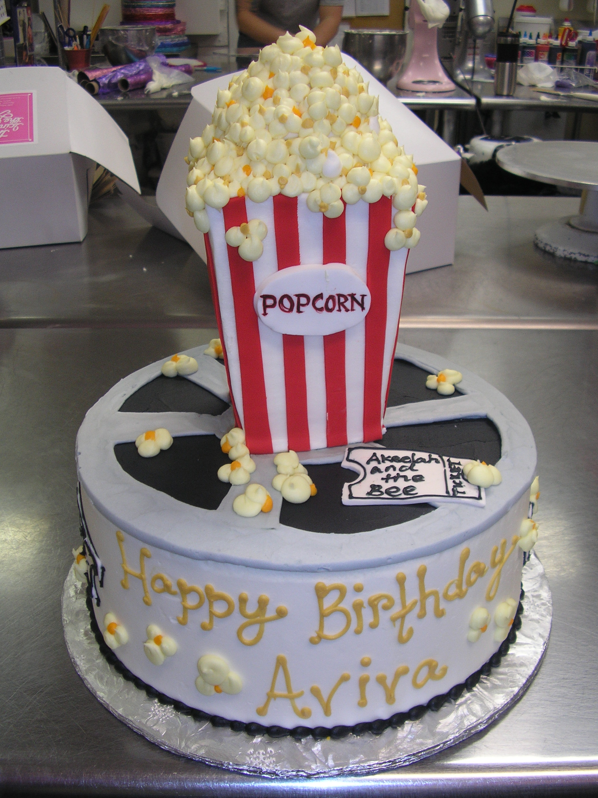 3D popcorn and movie reel on a cake